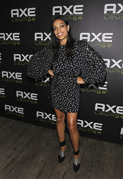 Rosario Dawson modernized her billowing star print dress with a pair of pointy black ankle boots with metallic silver details and thick ankle cuffs.
