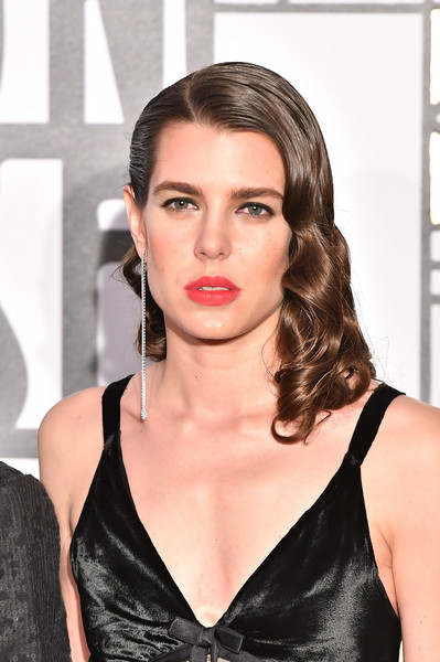 Charlotte Casiraghi polished off her look with a dangling diamond earring.