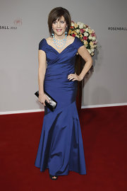 Birgit Schrowange looked regal at the Rosenball in an iridescent blue mermaid gown.