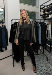 Rosie Huntington-Whiteley looked perfectly polished in a silver sequin jacket at the Rosie HW x Paige Fall collection launch.