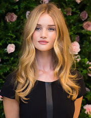 Rosie was glowing at the launch of her lingerie collaboration with center-parted blond waves.