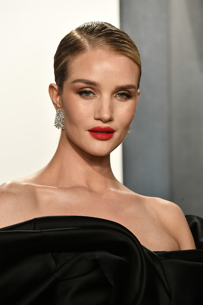 Rosie Huntington-Whiteley Classic Bun [hair,face,lip,hairstyle,eyebrow,fashion,beauty,fashion model,chin,skin,transformers,radhika jones - arrivals,rosie huntington-whiteley,actor,fashion,model,hair,wallis annenberg center for the performing arts,oscar party,vanity fair,rosie huntington-whiteley,transformers: dark of the moon,vanity fair,oscar party,fashion,wallis annenberg center for the performing arts,actor,model,transformers,photograph]