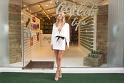 Rosie Huntington-Whiteley kept it fierce all the way down to her Giuseppe Zanotti snakeskin sandals.