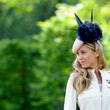 Florence Brudenell-Bruce in navy florals and feathers