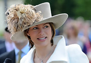 Kate Silverton turned heads with a statement dress hat adorned with fluffy feathers as she attended the Royal Ascot.