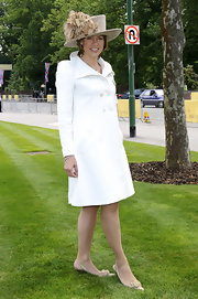 Kate Silverton looked prim and proper in a pristine white double-breasted coat at the Royal Ascot.