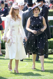 Princess Beatrice completed her look with a pair of nude cap-toe Mary Janes.