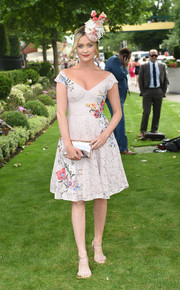 Laura Whitmore complemented her frock with a pair of beige ruffle sandals.