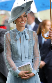 Kate Middleton attended Royal Ascot carrying an elegant gold clutch by Elie Saab.