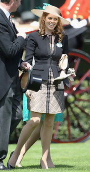 Princess Beatrice wore a sleek black zip-up blazer over her nude cocktail dress for the opening day of Royal Ascot.