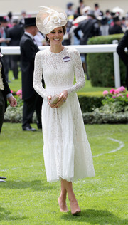 Kate Middleton looked angelic in a long-sleeve white lace dress by Dolce & Gabbana on day 2 of Royal Ascot.