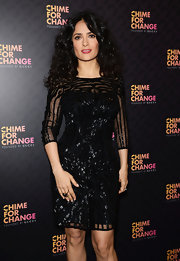 Salma Hayek's black beaded dress showed off her curves at the 'Chime For Change: The Sound of Change Live' Concert in London.