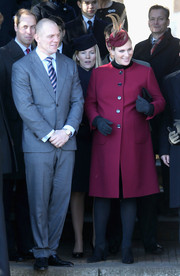 Zara Phillips chose a simple fuchsia wool coat for Christmas Day service.