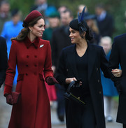Kate Middleton matched a wide burgundy headband by Jane Taylor with a double-breasted coat for Christmas Day church service.