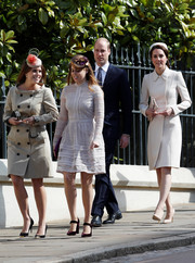 Princess Eugenie headed to Easter Day service wearing a beige trenchcoat.