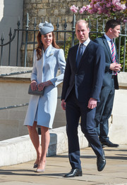 Kate Middleton headed to Easter service at St. George's Chapel wearing a baby-blue coat by Alexander McQueen.