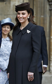 Kate Middleton adorned her black coat with a pearl brooch for Easter service.
