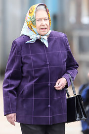 Queen Elizabeth loves to wear beautifully printed and brightly colored silk scarves over her hair.  We think it's quite elegant.