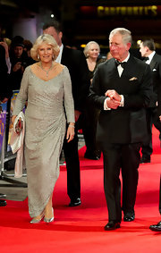 Camilla wore a glittering silver gown with long sleeves and a ruched hip design for the 'Hugo' premiere.