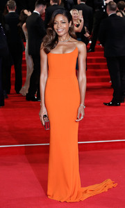 Naomi Harris was svelte and elegant in a floor-sweeping orange strapless dress by Stella McCartney at the royal film performance of 'Spectre.'