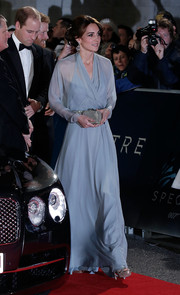 Kate Middleton was the picture of graceful elegance in a powder-blue wrap gown by Jenny Packham during the royal film performance of 'Spectre.'