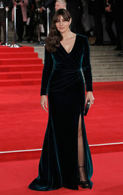 Monica Bellucci kept it timeless in a dark teal velvet wrap gown by Ralph & Russo Couture at the royal film performance of 'Spectre.'