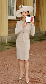 Catherine Zeta Jones looked ladylike at Buckingham Palace in demure gold pumps.