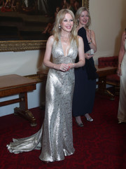 Kylie Minogue shone in a silver halter gown with a flowing train at the Royal Marsden Trust reception.