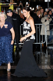 Meghan Markle paired a long black skirt with a monochrome sequined top for the Royal Variety Performance 2018.