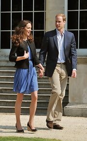 Prince William wore his favorite ensemble of corduroys and a blue blazer with a pair of leather loafers.