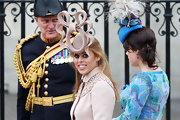 Princess Beatrice wins for the most interesting headpiece of the wedding with a dramatic bow cream fascinator.