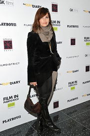 Gina Gershon bundled up at 'The Rum Diary' premiere in NYC. She topped off her look with flat black leather boots.