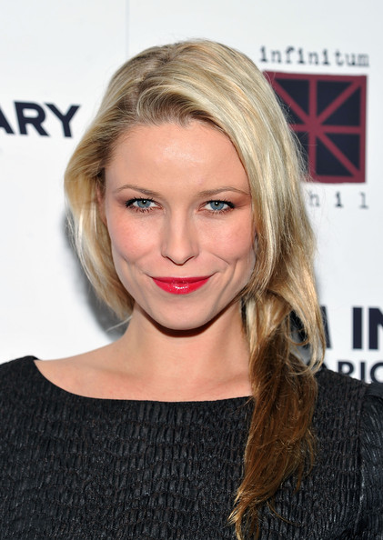 At the NYC premiere of 'The Rum Diary,' Kiera Chaplin turned up the volume on glamour by adding a brilliant red lip to her look.