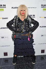 Betsey Johnson topped off her eclectic ensemble at 'The Rum Diary' with black and white sneakers.