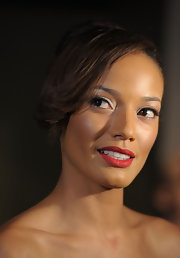 Selita Ebanks looks stunning in matte brick red lipstick blended seamlessly into her lips.