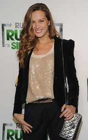 Petra wears a sequins covered tank to dazzle up her dark blazer and pants.