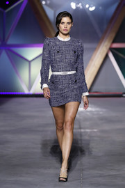 Sara Sampaio flaunted plenty of leg in a blue tweed mini dress at the Fashion for Relief runway show.