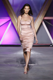 Bella Hadid showed off her supermodel figure in a ruched blush cocktail dress on the Fashion for Relief runway.