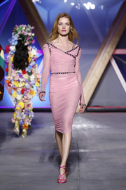 Natalia Vodianova walked the Fashion for Relief runway wearing a ruched pink dress with a crossover neckline and stud detailing.