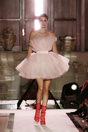 Kendall Jenner cut a flirty figure in a strapless pink tulle dress while walking the Giambattista Valli Loves H&M runway.