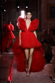 Kendall Jenner looked ready for Valentine's Day in this red tulle fishtail dress at the Giambattista Valli Loves H&M show.
