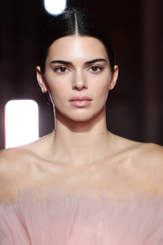 Kendall Jenner walked the Giambattista Valli Loves H&M runway wearing her hair in a center-parted ponytail.