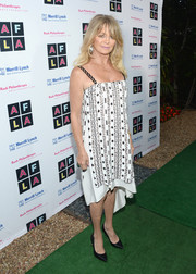 Goldie Hawn made an appearance at the Art for Life Los Angeles event wearing a black-and-white printed slip dress.