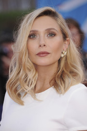 Elizabeth Olsen attended the Deauville American Film Festival premiere of 'Ruth and Alex' wearing her hair in a wavy lob.