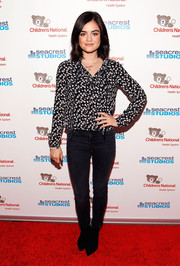 Lucy Hale pairs a printed long-sleeve blouse with skinny black cigarette jeans and pointed booties for a sleek look