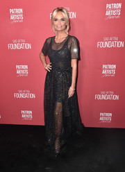 Kristin Chenoweth attended the Patron of the Artists Awards wearing a sheer, beaded black gown.