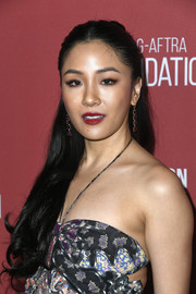 Constance Wu polished off her look with a pair of dangling gemstone earrings by Irene Neuwirth.
