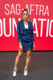 Keke Palmer went business-chic in a navy pinstriped skirt suit by J.ING at the SAG-AFTRA Foundation Conversation: 'Hustlers.'