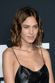 Alexa Chung framed her face with a short wavy hairstyle for the Saint Laurent show.