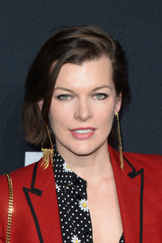 Milla Jovovich attended the Saint Laurent show wearing a casual short 'do.